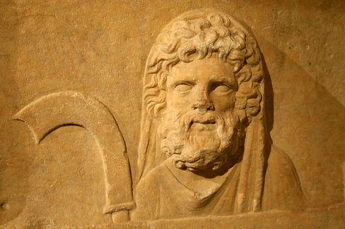 saturn-god-carving